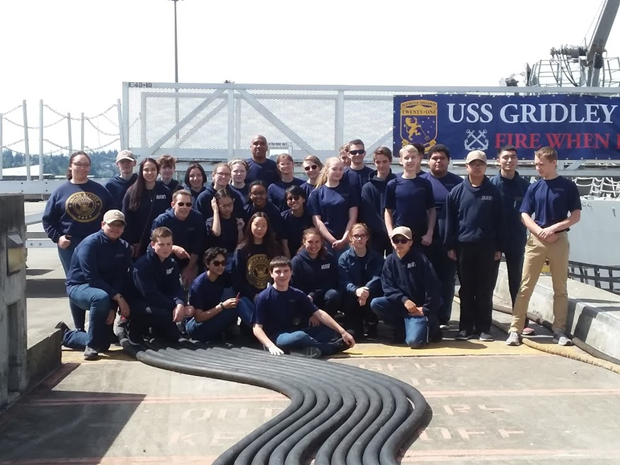 Cadets take a group photo after their tour on board USS Gridley (DDG 101).