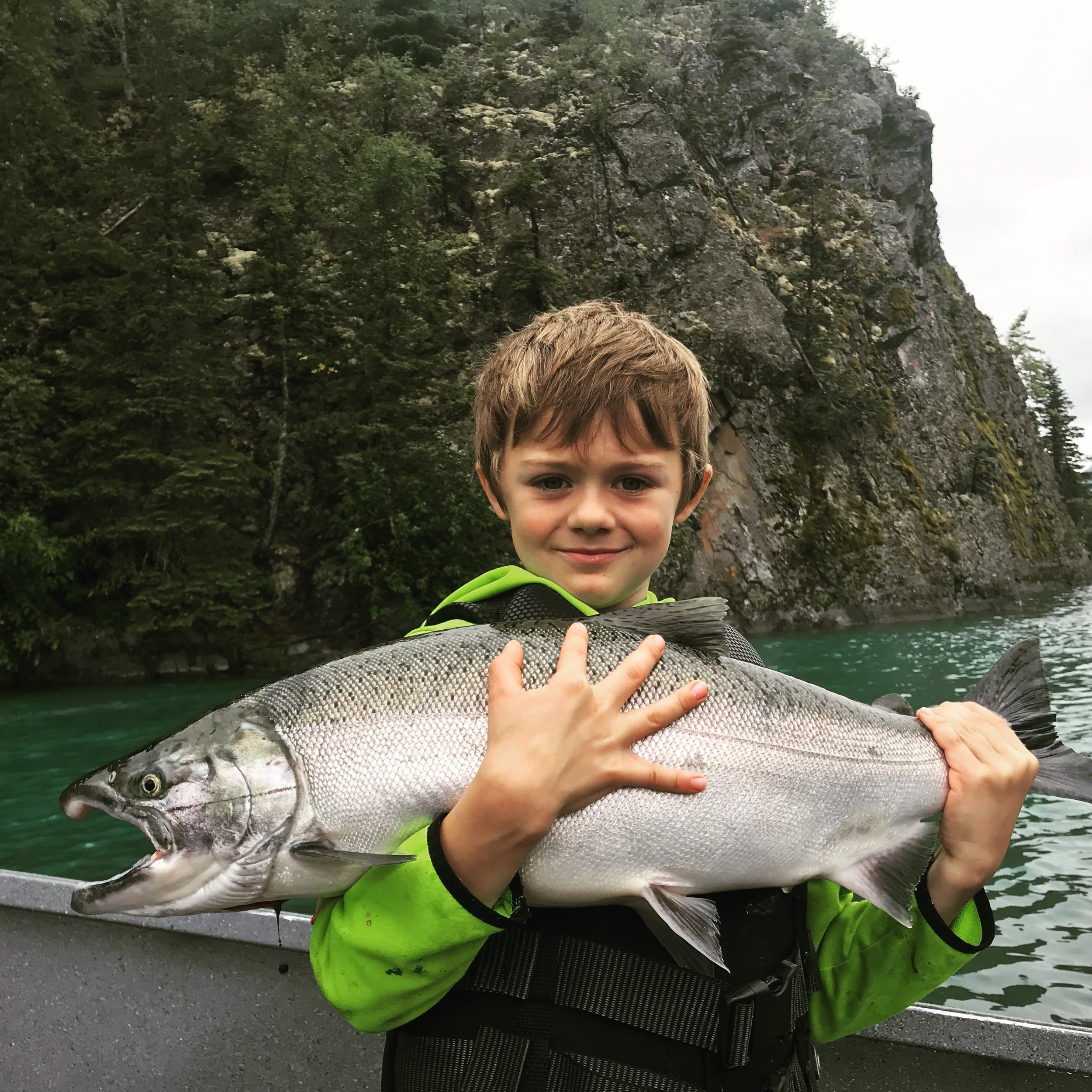 Bright Coho(silver) salmon on the fly! Come and catch one of the acrobats yourself and fill your freezer with fresh organic meat!