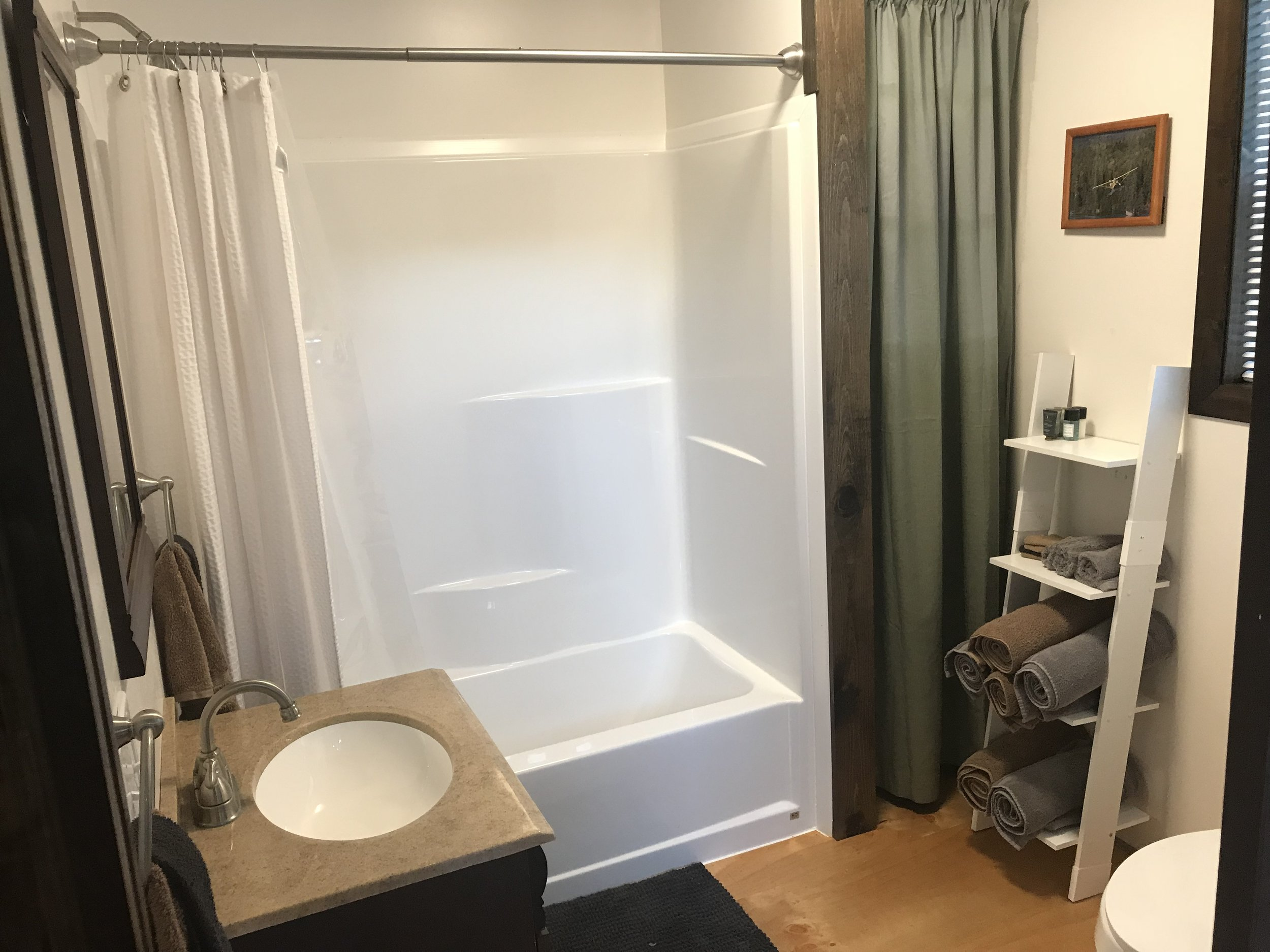 Clean and new bathroom with endless hot water!