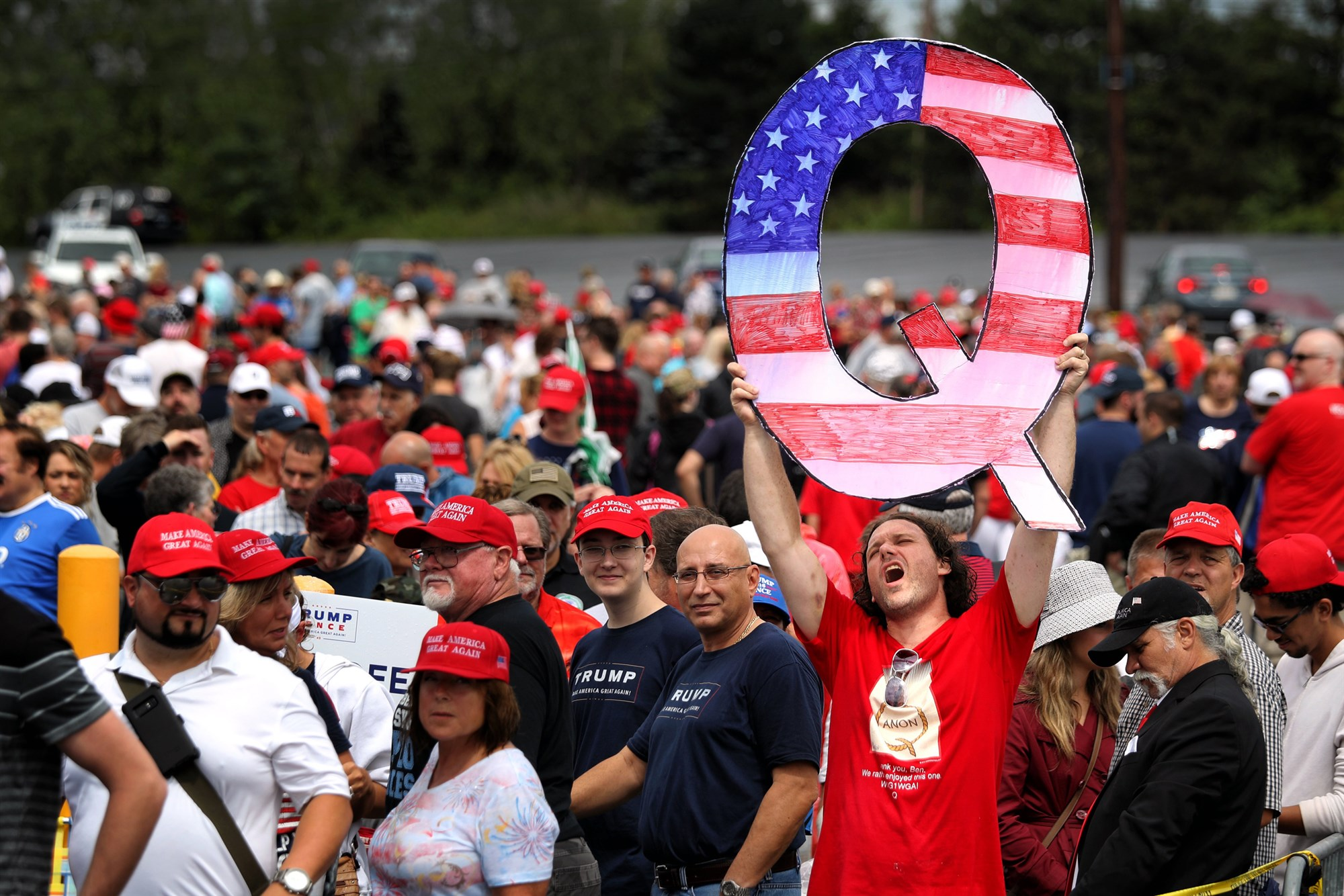 """Q"" is the only sign at this Trump rally spelled correctly."