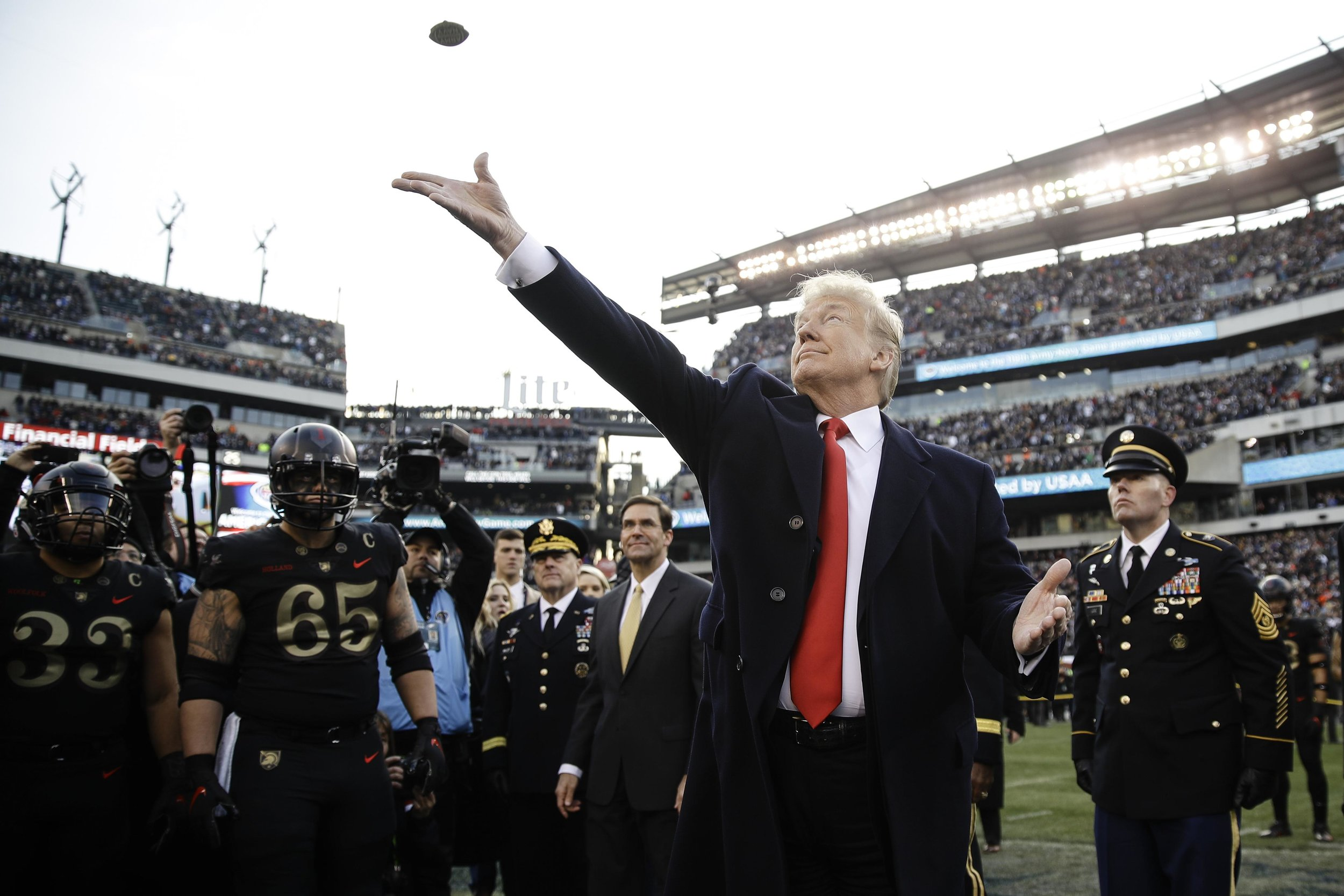 "Here he is fucking up the coin toss at the Army-Navy game. ""You're free coin, fly!"""
