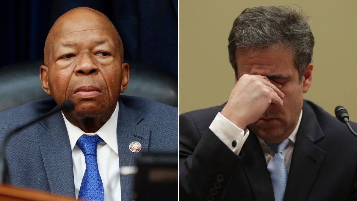 Rep. Elijah Cummings looks on as Michael Cohen struggles to contain his emotions.