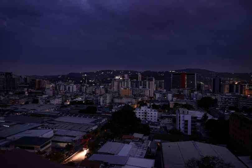 Night falls on a powerless Caracas.
