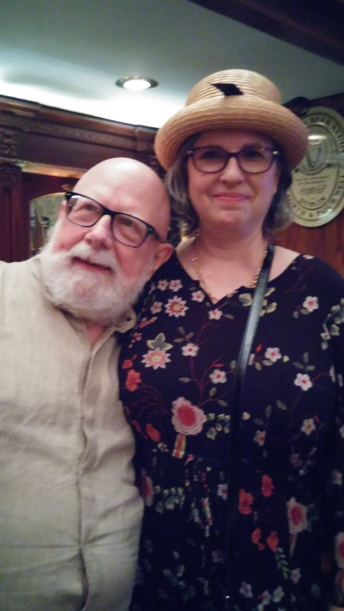 Me wearing the Mrs. Breen hat on Bloomsday last year, posing with Count Leonard.