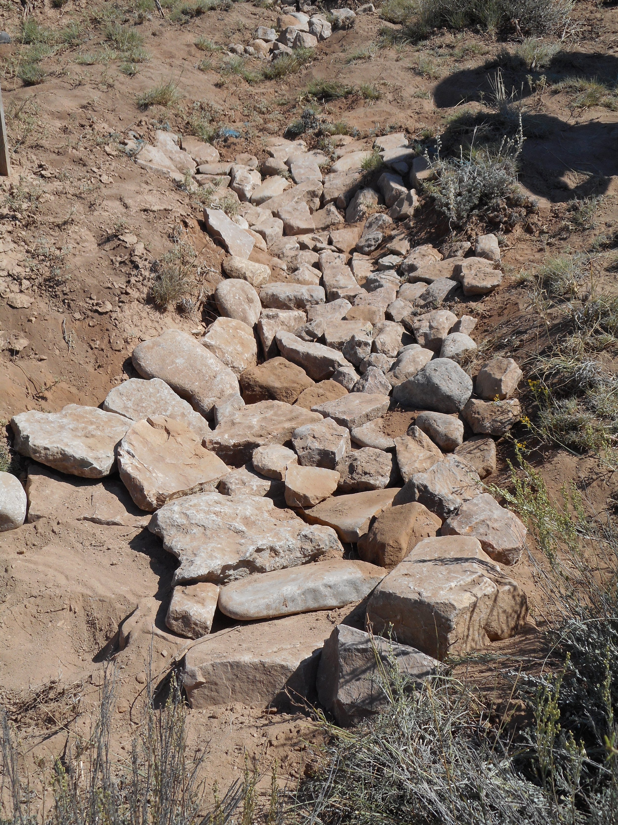 Click  here  to see a video of how to build a rock rundown to control erosion.