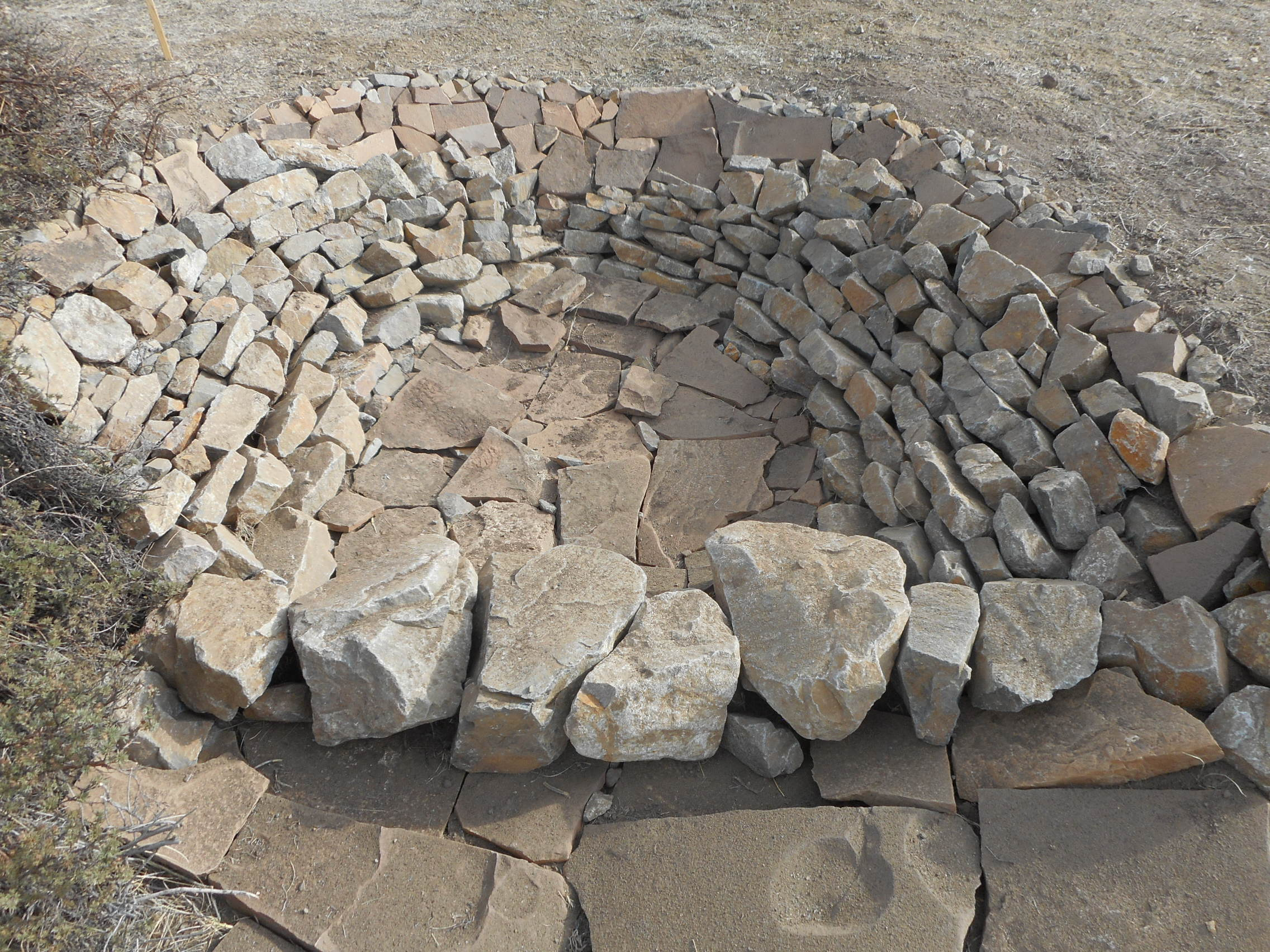 A Zuni Bowl built to stop a head cut from continuing to erode the land by migrating upstream.