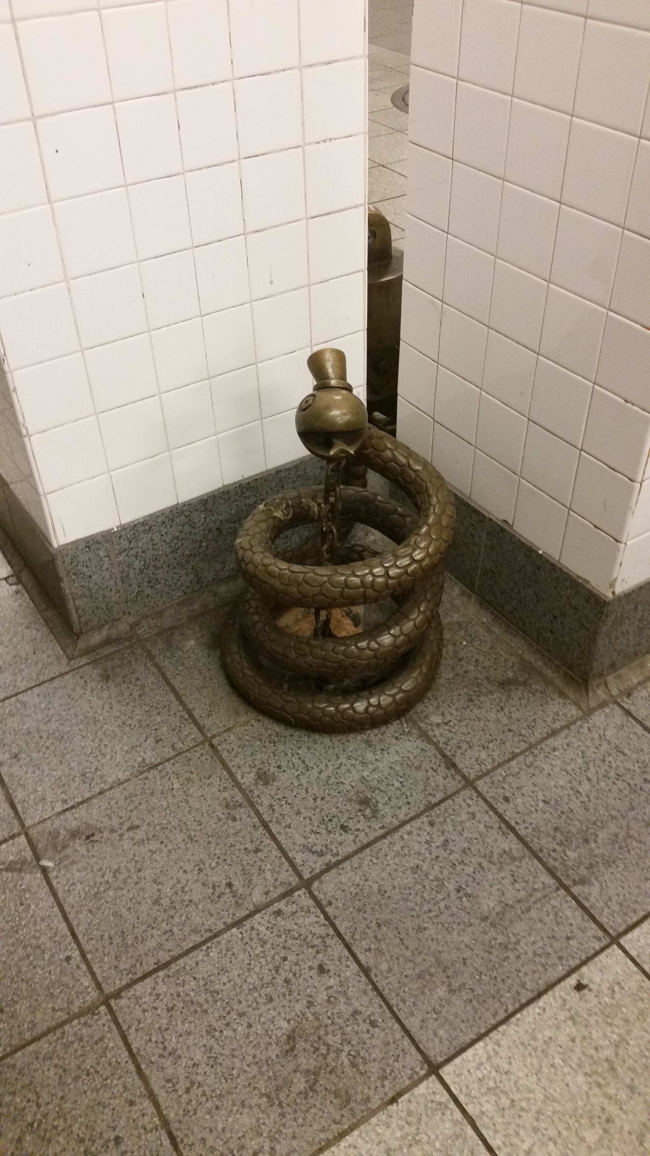 coiled snake statue in subway.jpg