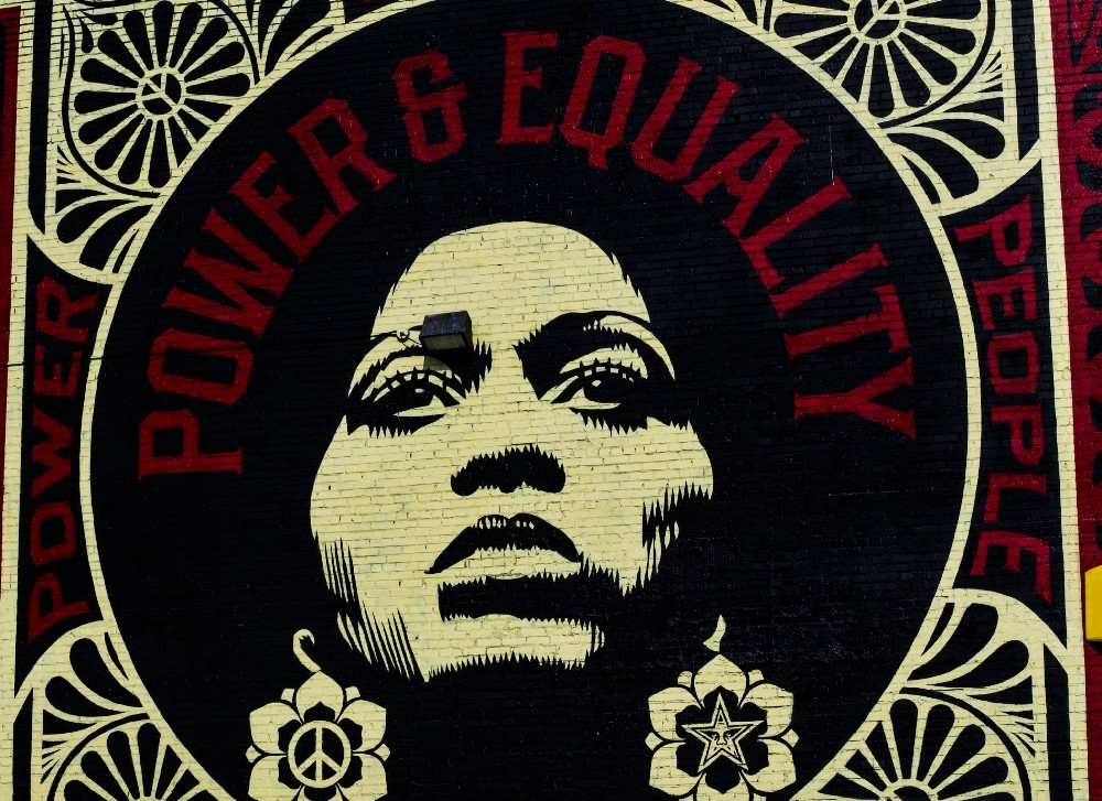 Photo by  Mana Amir  on  Unsplash  — Power & Equality by Shephard Fairey