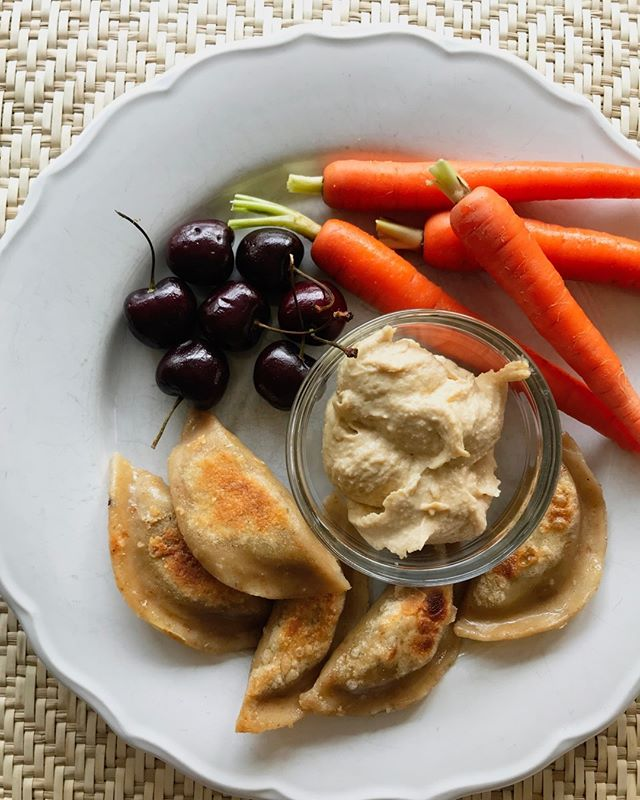 This is a lunch of odds and ends...you know the type. 😉 The hummus was supposed to go with the carrots but my son started dipping his veggie dumplings into it instead and a new combo was born.  To us, this is what happa is all about -- taking old favorites and eating them with new ones, making new food traditions (even if it is a hastily thrown-together lunch!) Enjoy those dumplings....with hummus or whatever you please!  #happakitchen #dumplings #potstickers #hummus #feedingkids  #easyhealthykids #whatifeedmykids #easylunch