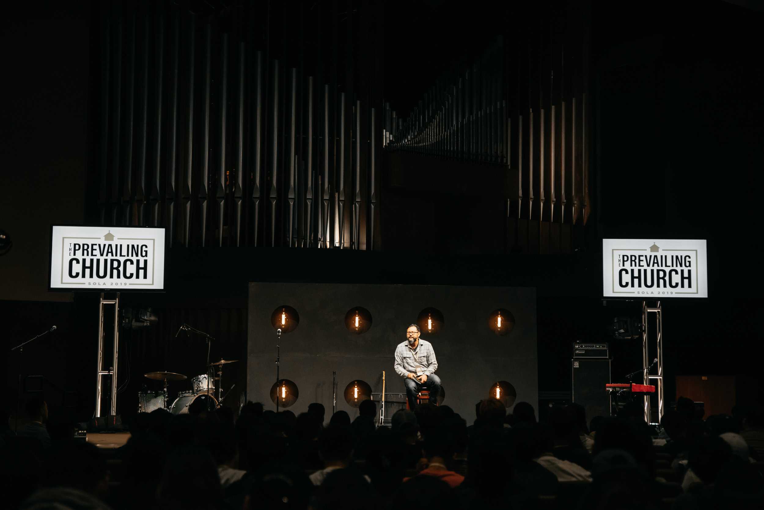 Pastor DL preaches during Session One of the SOLA conference