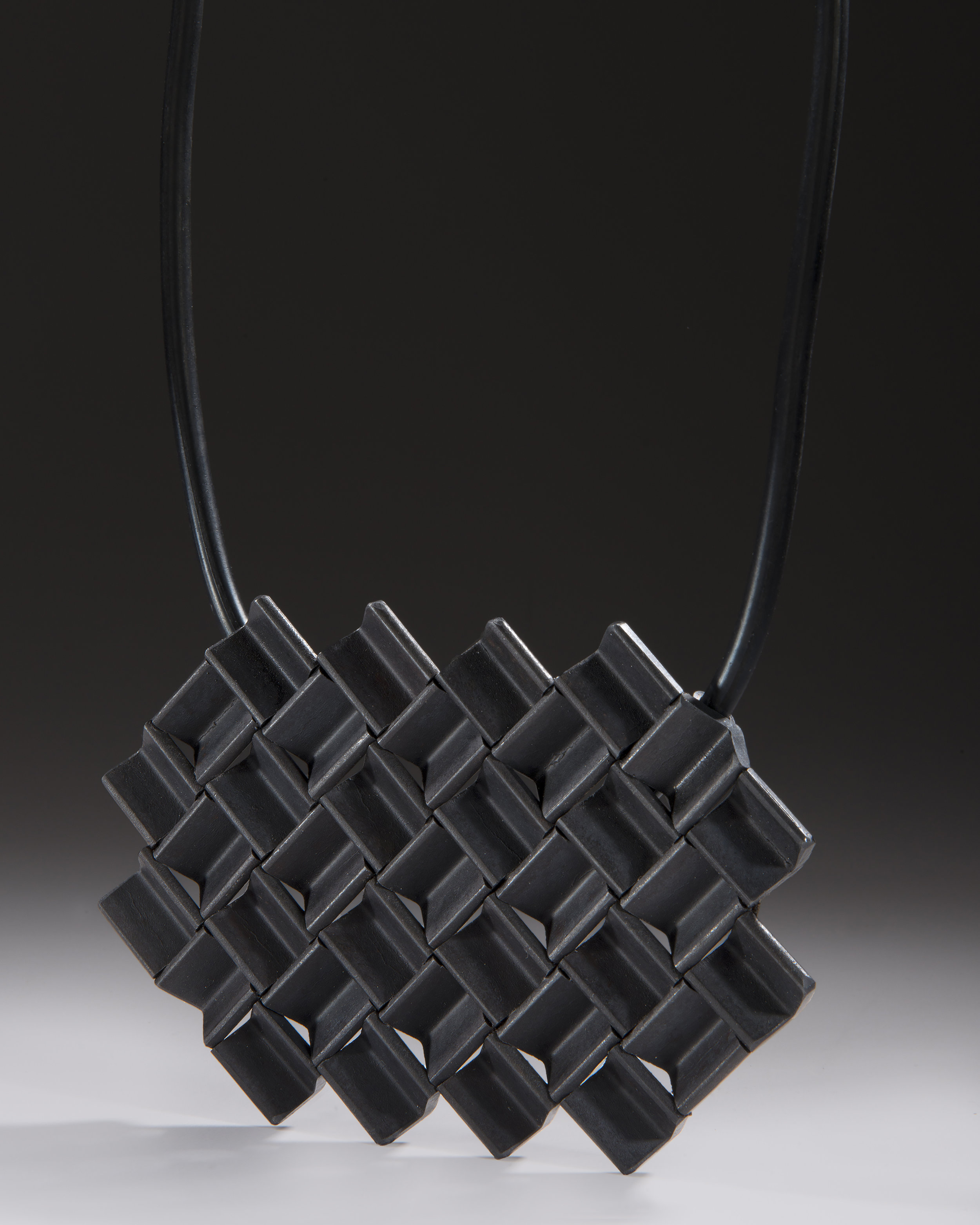 A Weld Study Pendant 6, Reclaimed Steel, and Stainless Steel, Rubber Tubing, Silver 4''x6.5''x22'', 2018.jpg
