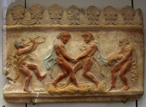 (1st Century AD Roman relief showing traditional grape treading)