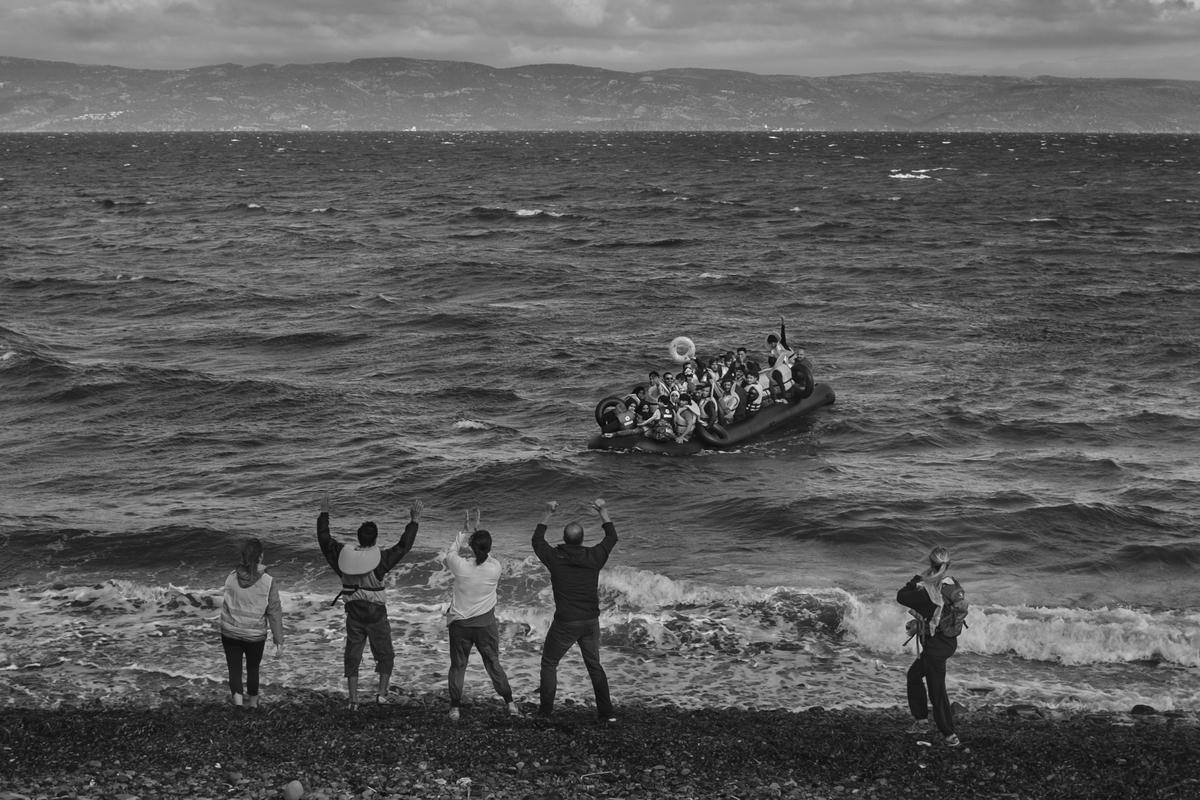 Refugees primarily from Syria, Iraq and Afghanistan are called to by volunteers as they land near Scala, on the island of Lesvos, Greece on September 30, 2015.