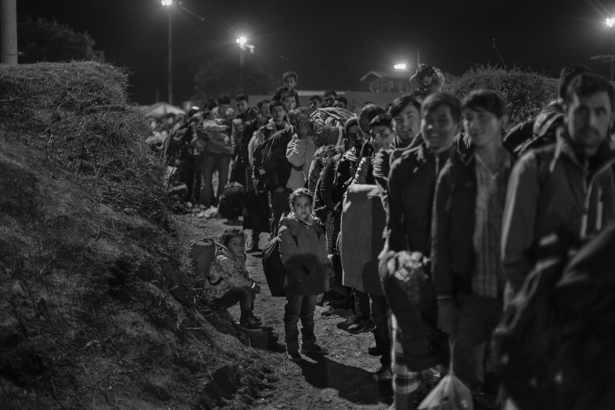 Refugees and migrants enter a registration and transit center in Opatovac, Croatia, on October 7, 2015. Approximately 4000-5000 people, mostly from Afghanistan, Iraq, and Syria, pass through this border town every day on their way to Western Europe.