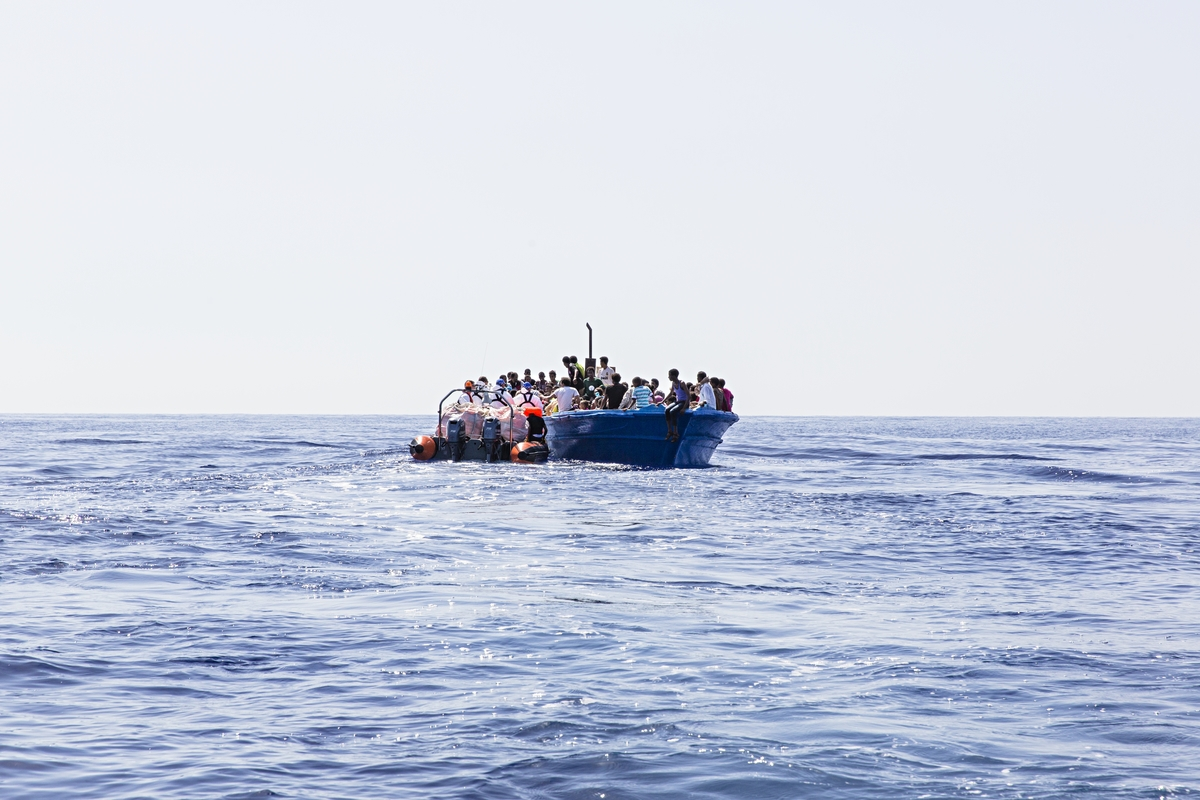 "Strait of Sicily, September 2, 2015. Eritrean migrants are seen in their boat as they are about to be rescued 40 miles from the Libyan coasts by a ship hired by MOAS and MSF (Medecines sans Frontieres). The ship named ""Phoenix"" was patrolling when the two drones found 3 wooden fishing boats coming probably from Zuwara (Lybia)."