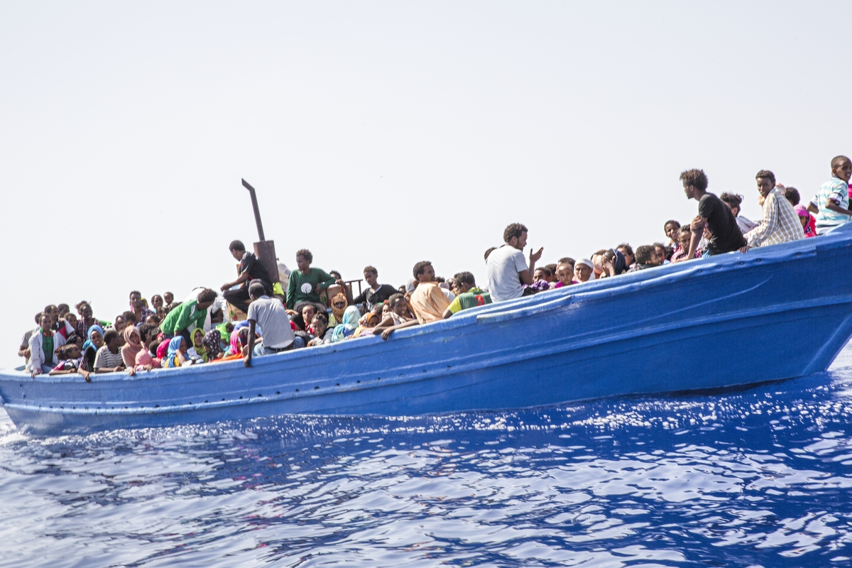 Strait of Sicily, September 2, 2015. Eritrean migrants are seen in their boat as they are about to be rescued 40 miles from the Libyan coasts by a ship hired by MOAS and MSF (Medecines sans Frontieres).