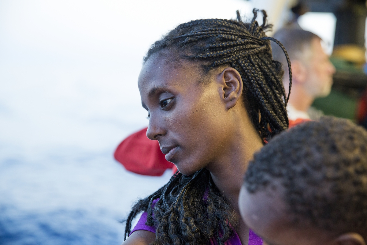 Strait of Sicily, September 3, 2015. During the 48 hours of sailing to the Italian port of Reggio Calabria, refugees from Eritrea, rescued by MOAS/MSF operation, are sadly looking to the sea.