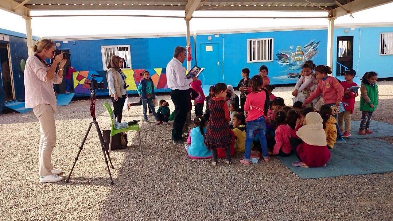 Photographing a reading session in Azraq Camp - Village 2
