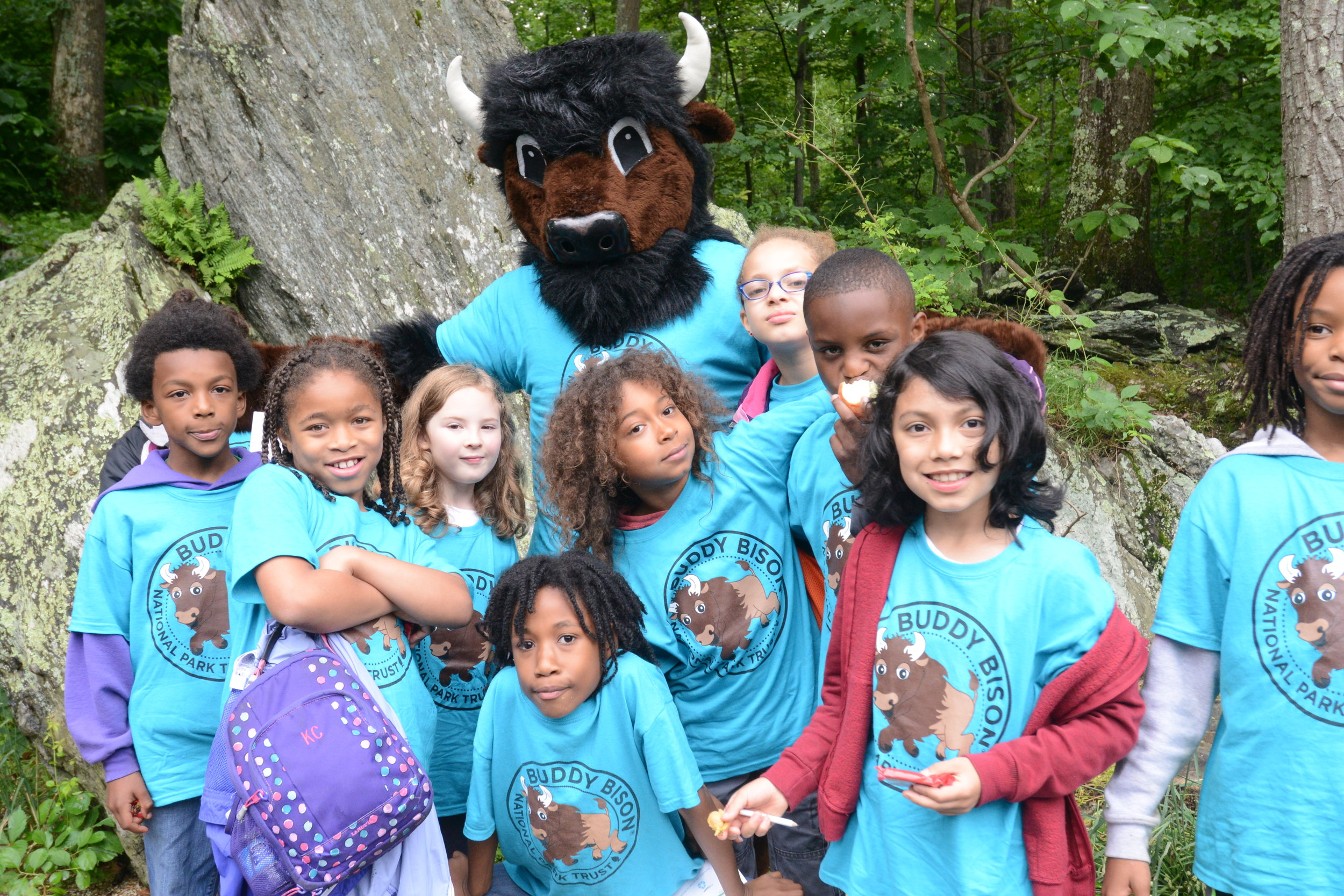 Children participate in an outdoor recreation program with Buddy Bison of the National Park Trust