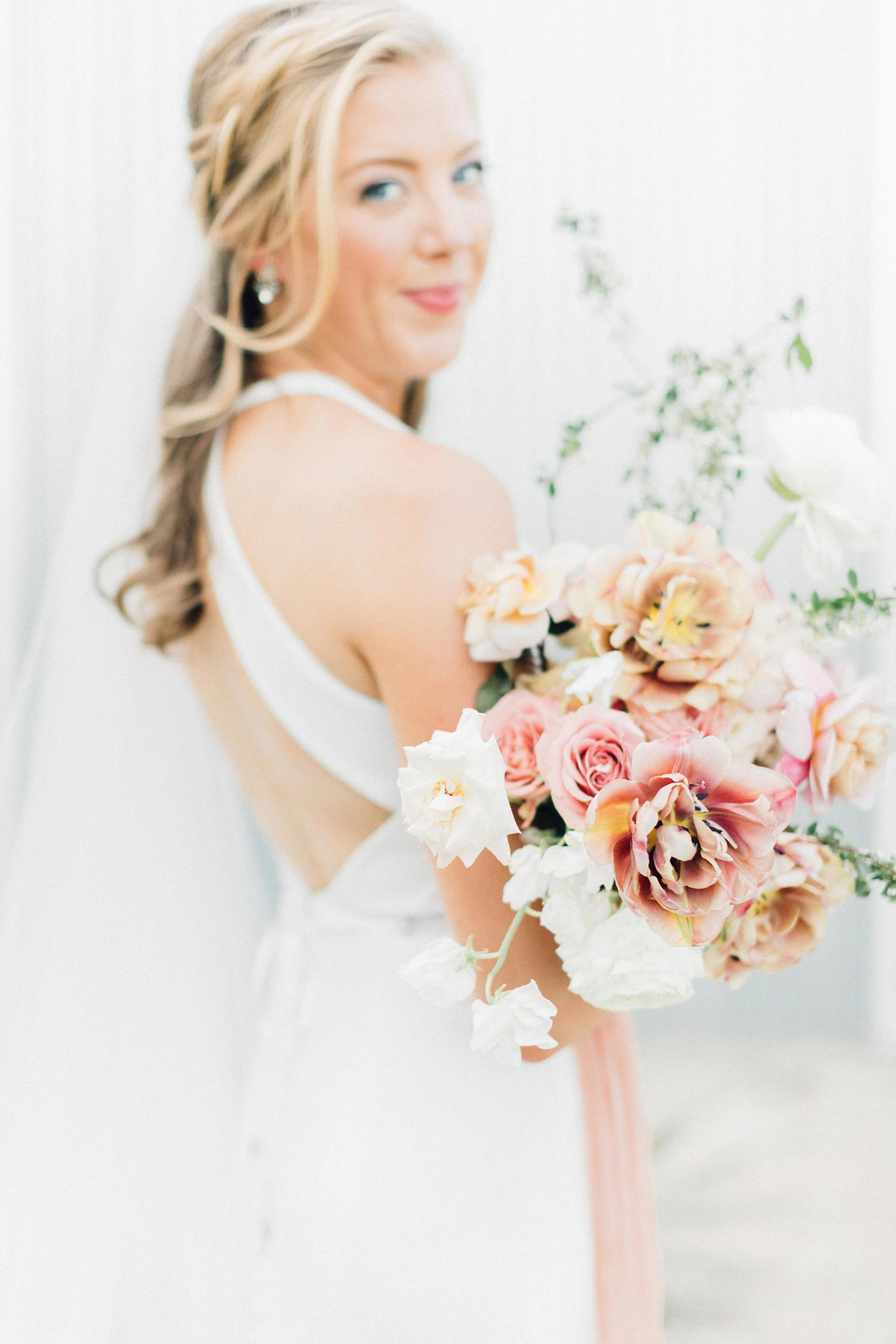 Flowers and bride by florist Color Theory Collective