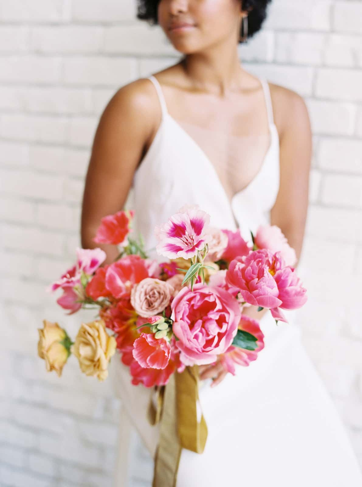 Bride holding lush bridal bouquet by Color Theory Collective