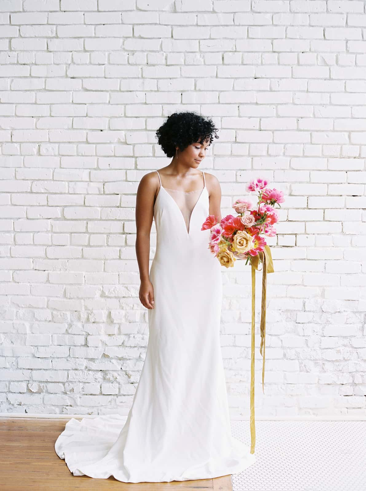 Bride with her bridal blooms designed by Color Theory Collective