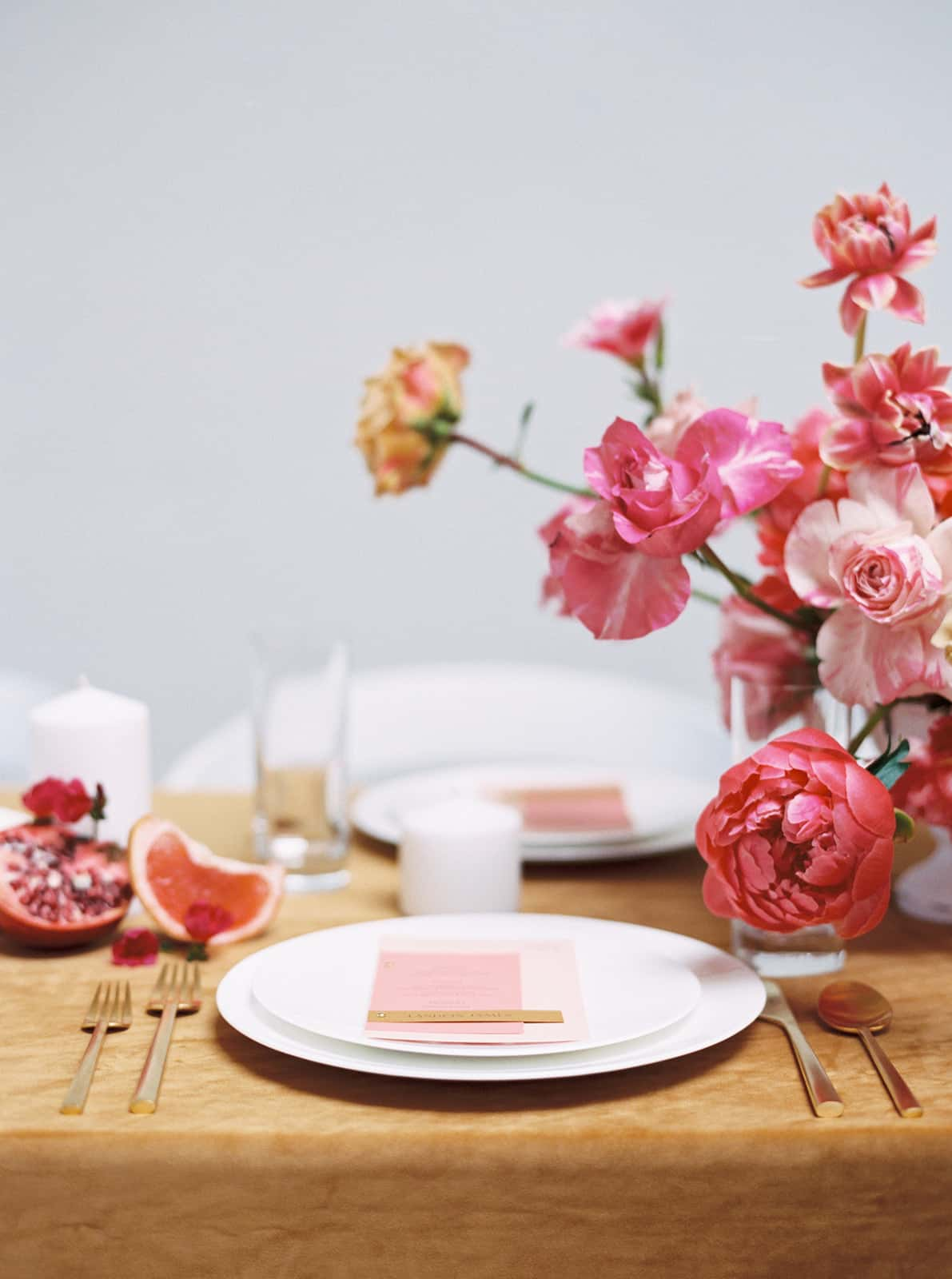 Wedding placesettings and florals designed by Color Theory Collective
