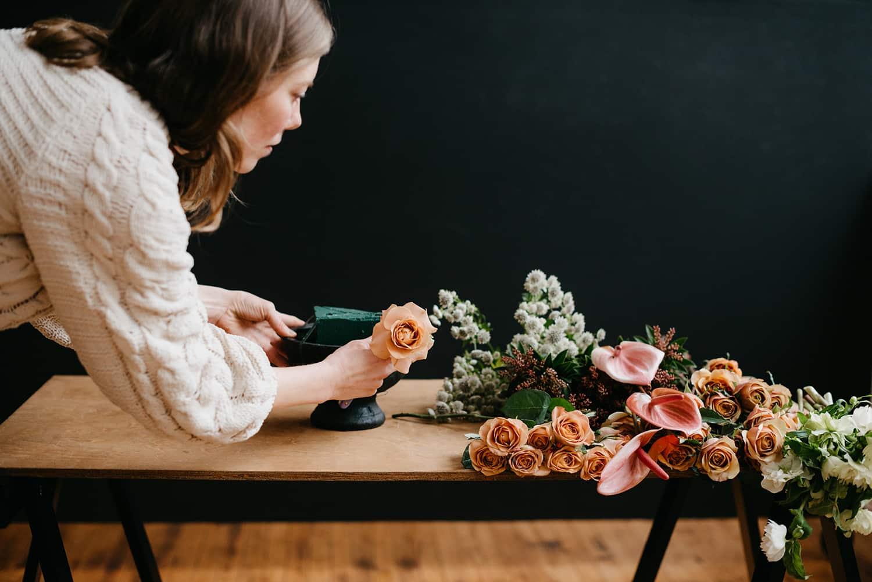 Florist in Portland Oregon demonstrates flower arrangement design