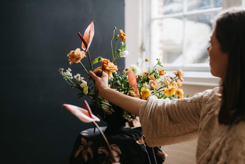 Portland florist arranging a flower display