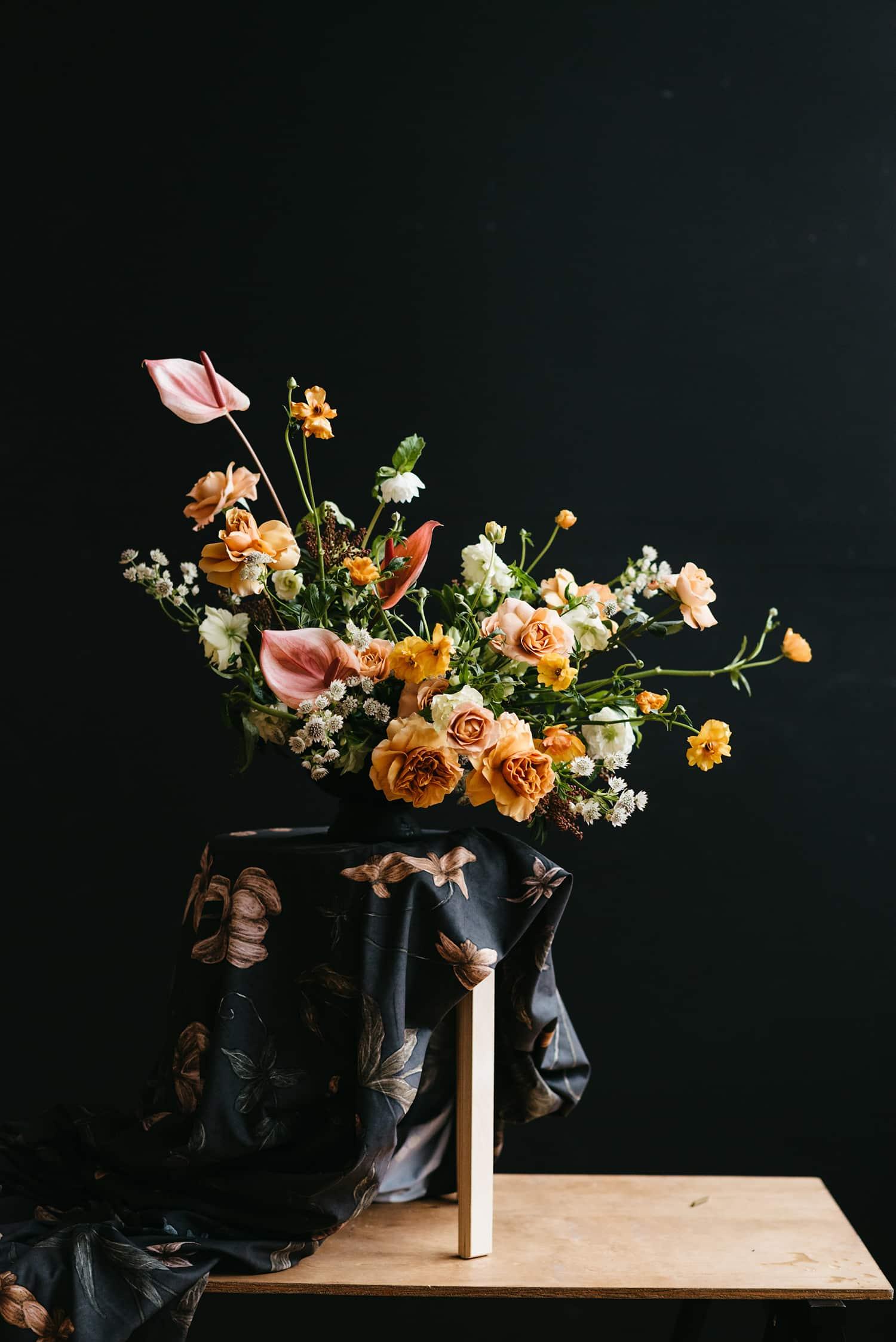 Floral designer and Portland florist Color Theory Collective demonstrates flower arranging.