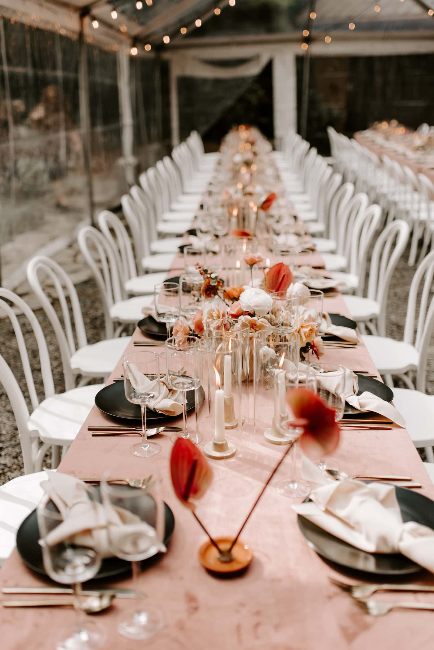 Copy of Floral on head table in wooded wedding