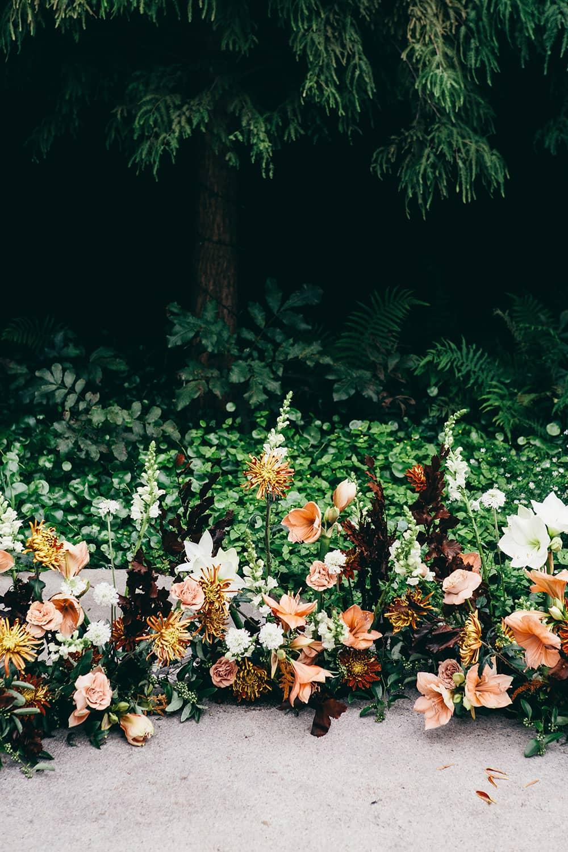 Portland-florist-wedding-ceremony-ground-floral-arch.jpg