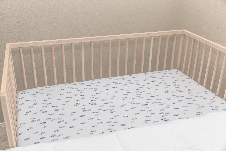 Portland florist displays crib arrangement in baby room