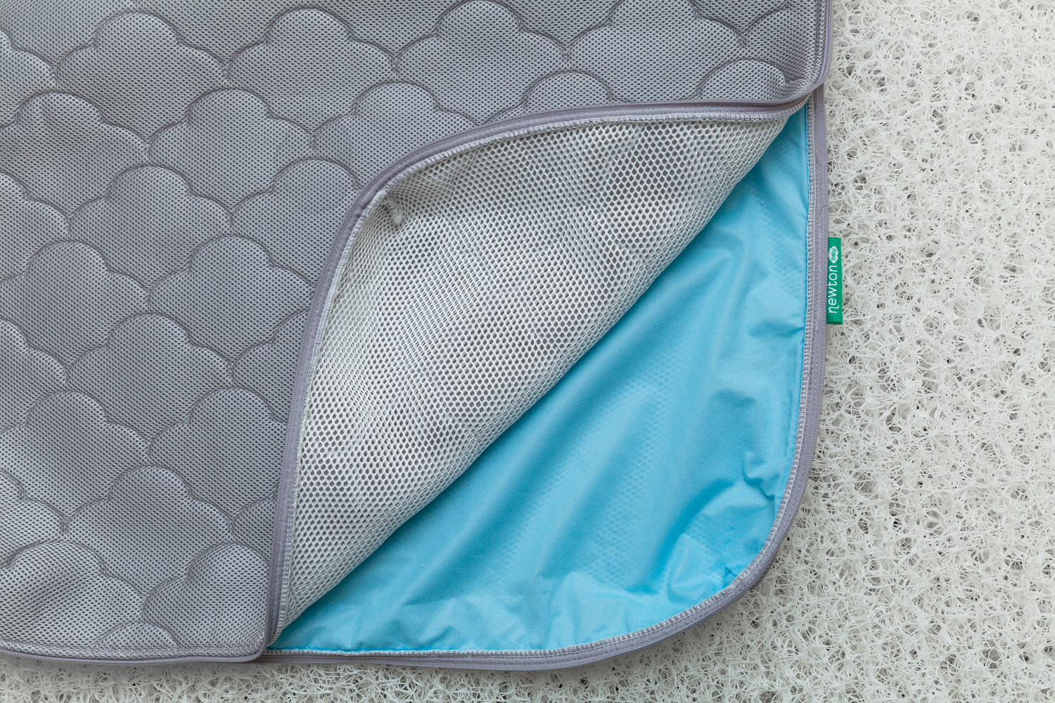 The unzipped 3D Spacer Cover displaying blue waterproof liner