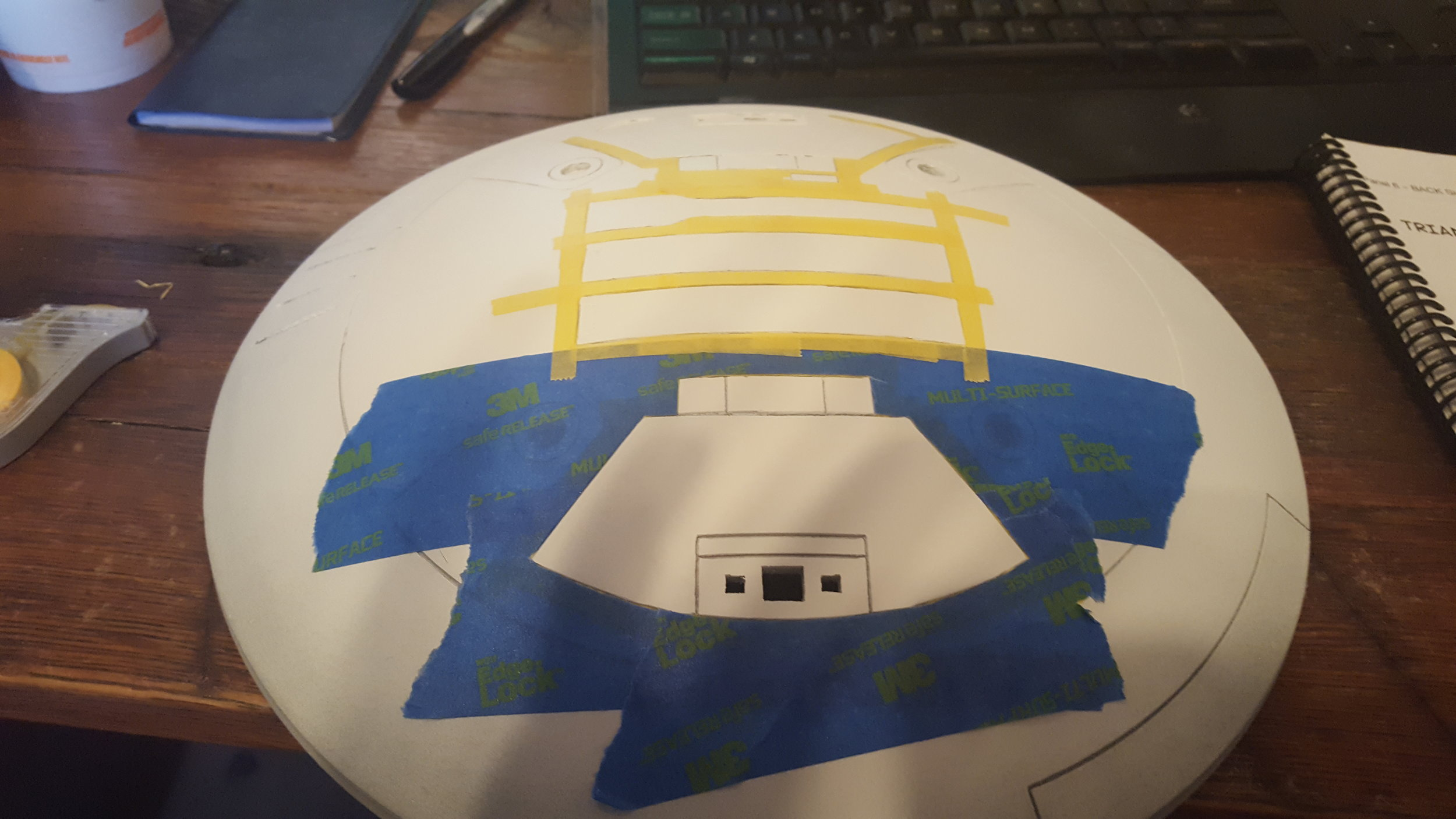 I began masking off for the silver. The yellow tape is a 6mm Tamiya masking tape which I really cant recommend enough. The small size lets you really get i there for the details and holds really well. The blue is just standard painters tape to cover off the big sections.