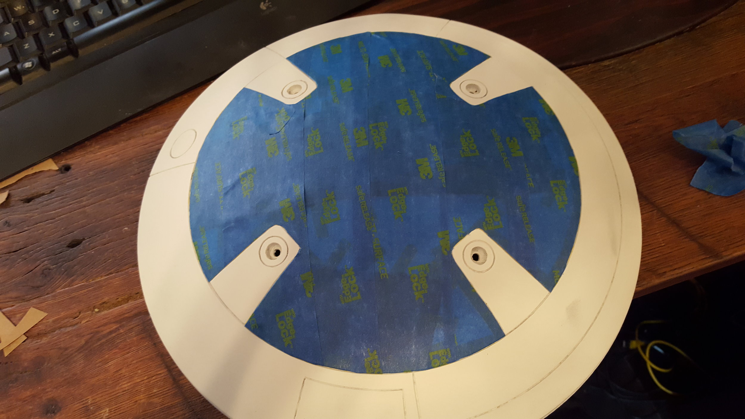 I used the same technique here. Using the Tamiya tape on the details then covering everything with blue tape and cutting it out.