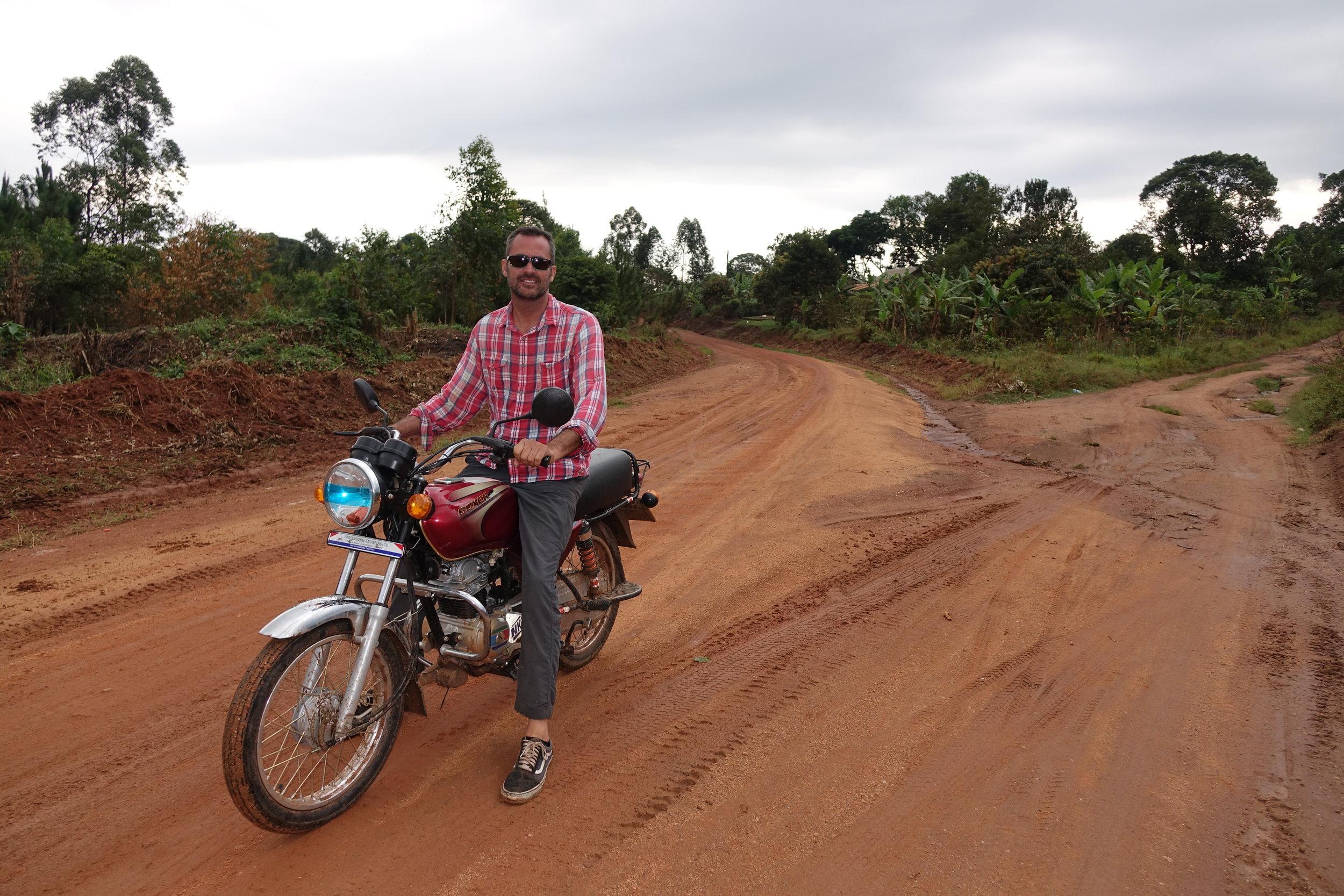 World Riders Foundation founder, Mike Haley, on a boda boda in rural Uganda.