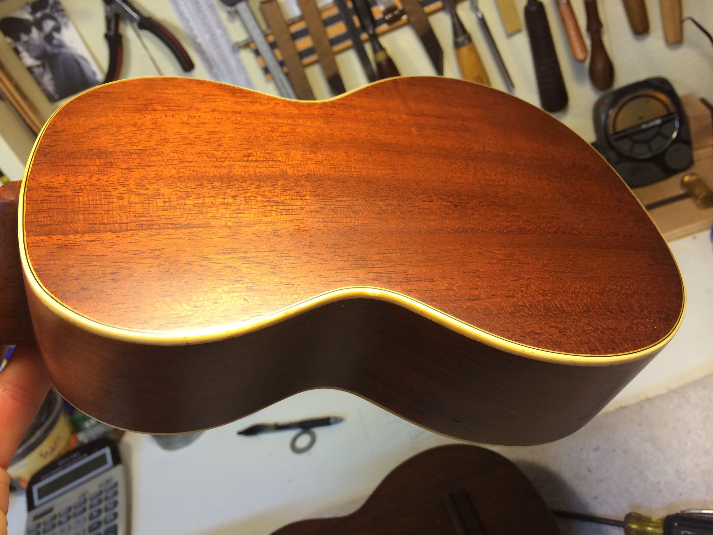 A replaced back, with the original binding saved and tinted for the warm glow of vintage nitro cellulose.