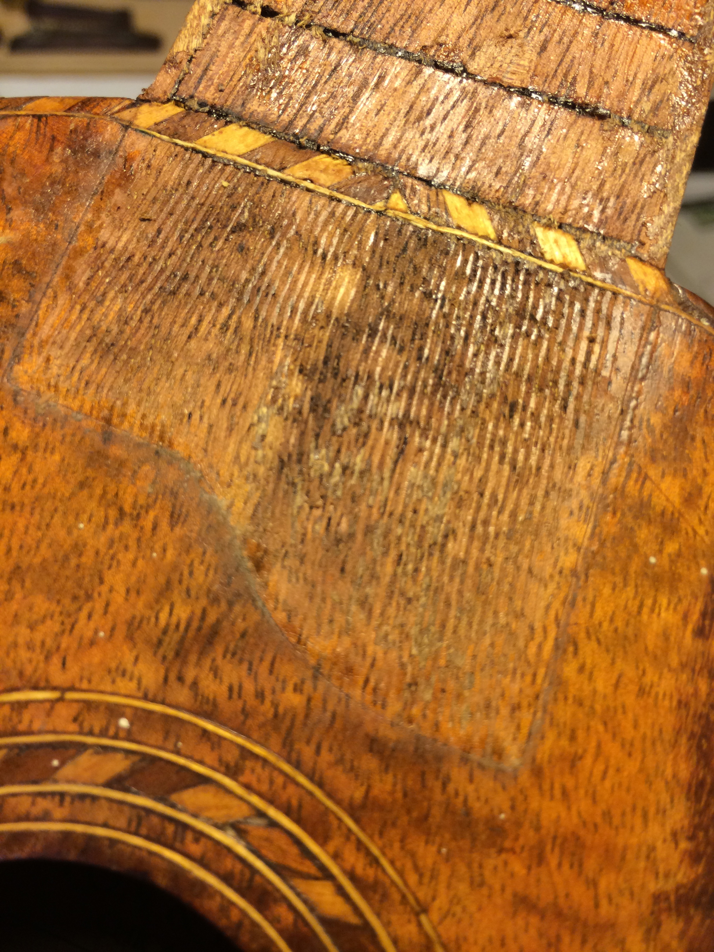 The real restoration begins. The person that added the fingerboard, likely in the 30s or 40s had scored the top when preparing for glue, this would be a challenge to make disappear.