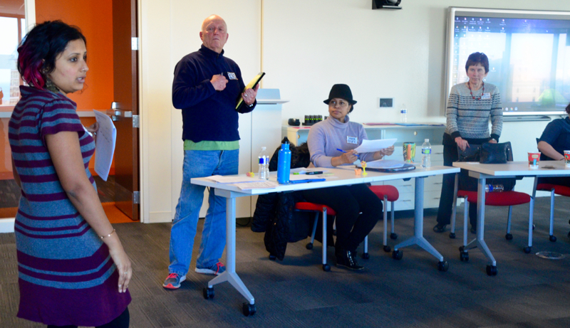 Seva Gandhi and Dick Alton lead a workshop exercise.