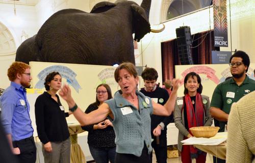 Laura Derks explains duties to 'Co-Lab' volunteers.