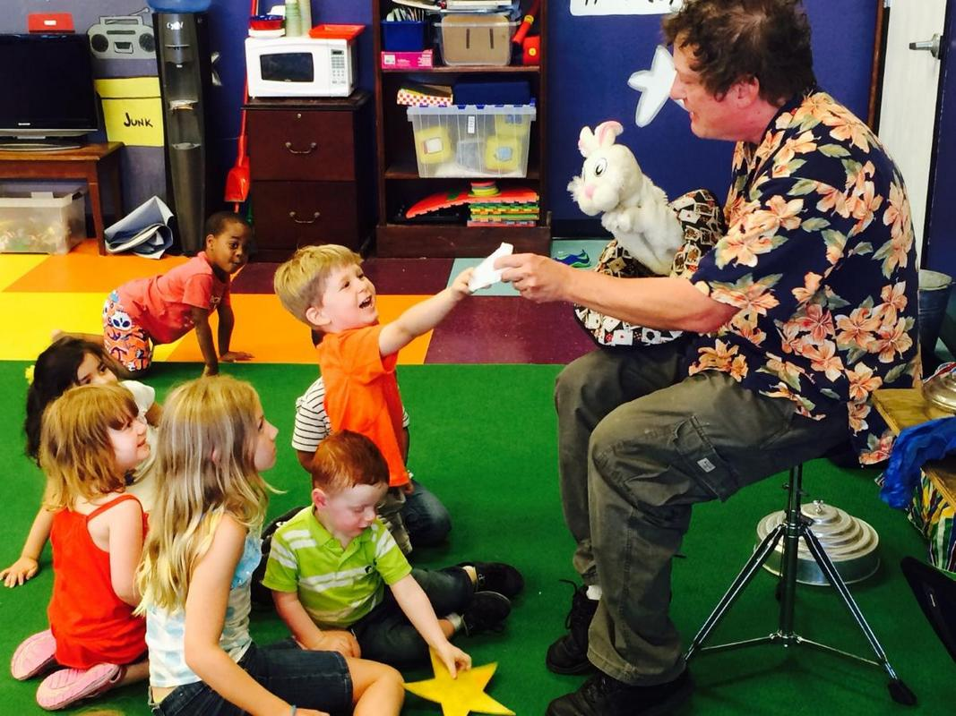 Magician interacts with Children