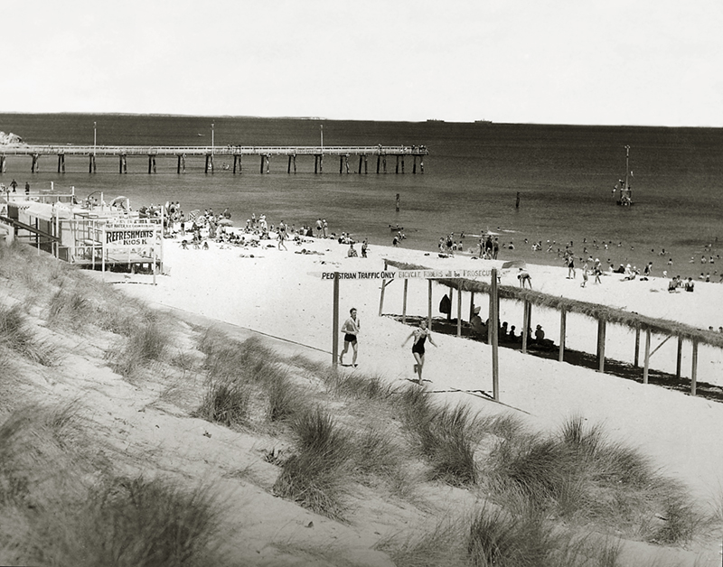 C17-Looking-north-to-the-jetty-from-the-Cottesloe-Surf-Lifesaving-Club-boathouse-and-Scoota-Car-track.-Marram-grass-planted-to-stablise-the-dunes-is-growing-in-the-foreground-1938.jpg