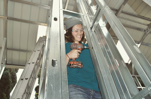 """Shaina Thompson is one of the founders of LATCH Collective. """"We started LATCH Collective in 2016 to meet the needs of novice do-it-yourself tiny house builders, which included us! Our tool belt is equipped with skills and knowledge in areas such as management, zoning, policy, community development, carpentry, compassion, and collaboration. Passionate tiny house advocates and DIYers, we live every day building a strong Community of Learners and Network of Professionals while building  our own tiny home ."""""""