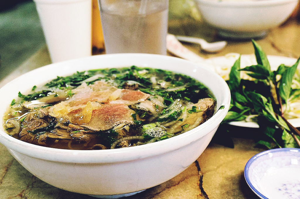A bowl of phở with a side of Thai basil. (Photo: David Leo Veksler.CC BY-SA 2.0)