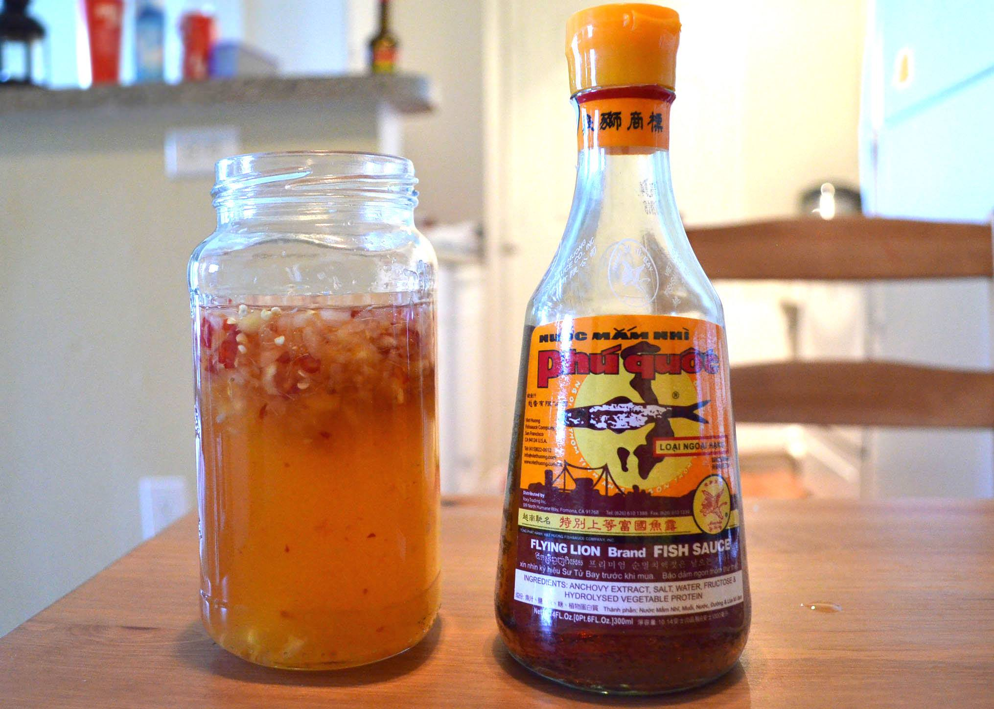A jar of dipping fish sauce, or nước mắm chấm, next to a bottle of nước mắm from Phú Quốc. (Photo: Loa/Kathy Triệu)