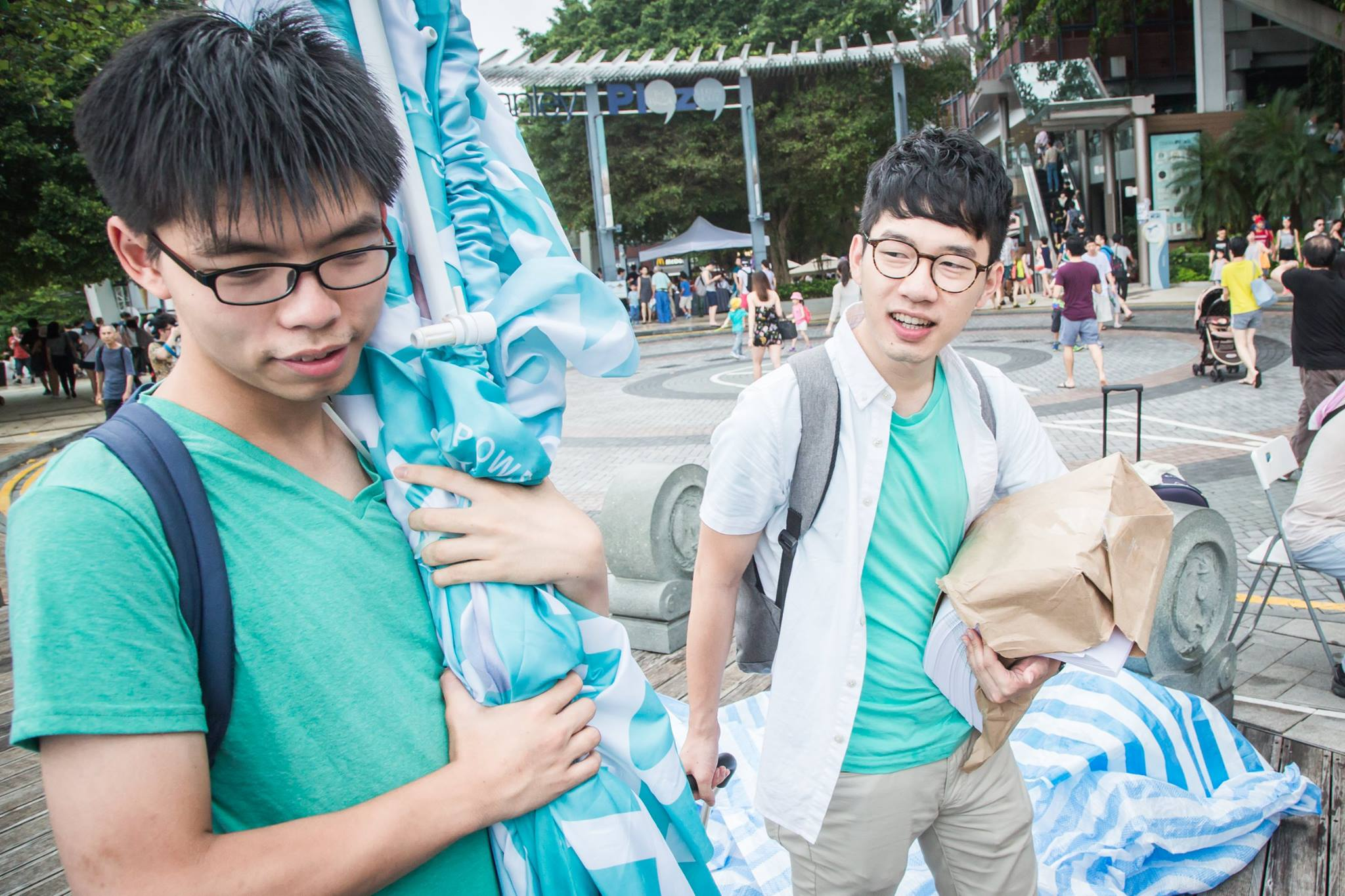 Joshua Wong (left) and Nathan Law (right) preparing to campaign on the street. (Photo: Facebook/Joshua Wong)