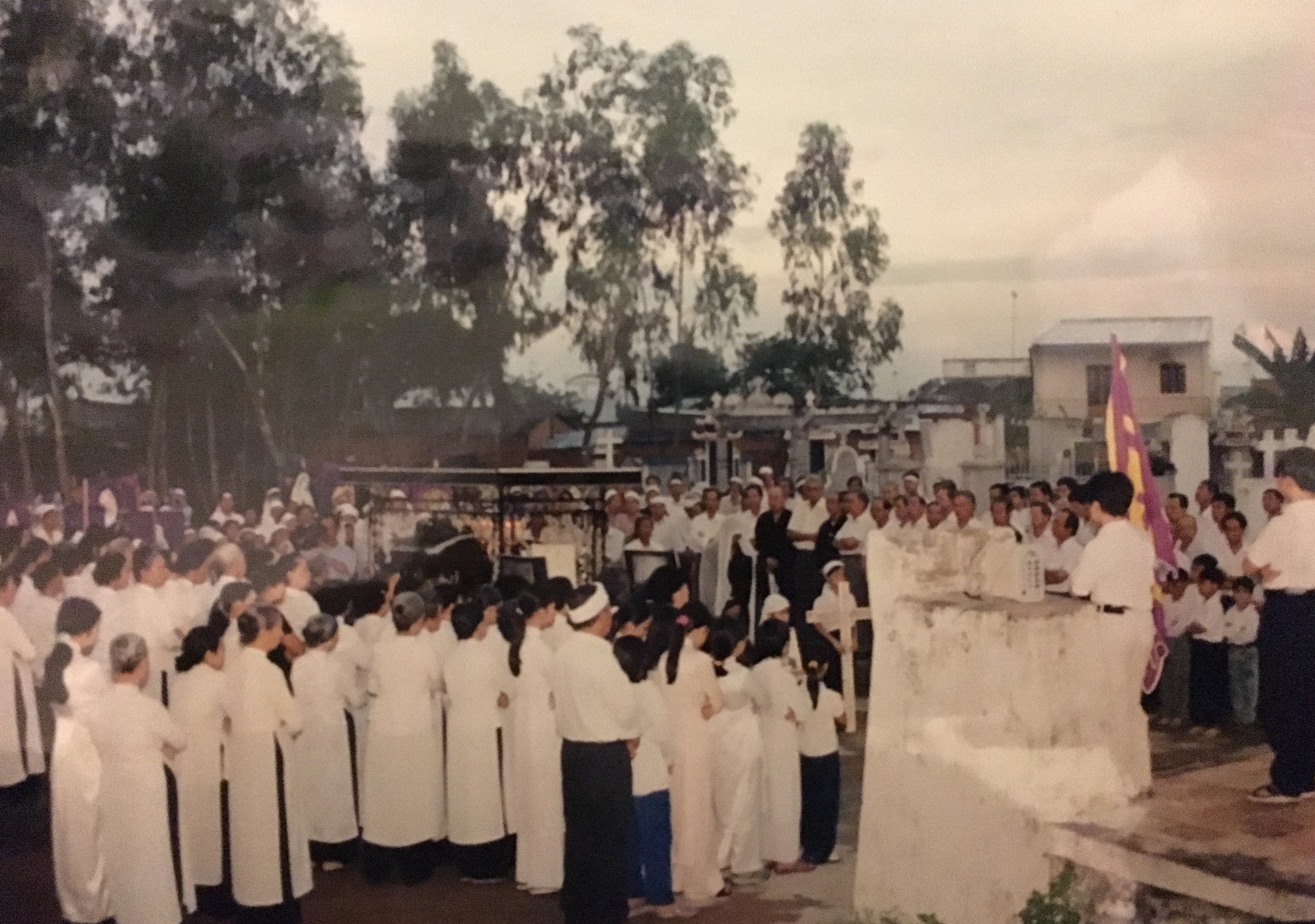 """""""A sea of white."""" Funeral procession for Thúy Vi Cao's grandfather in Việt Nam, 2002. (Photo: Cao family)"""