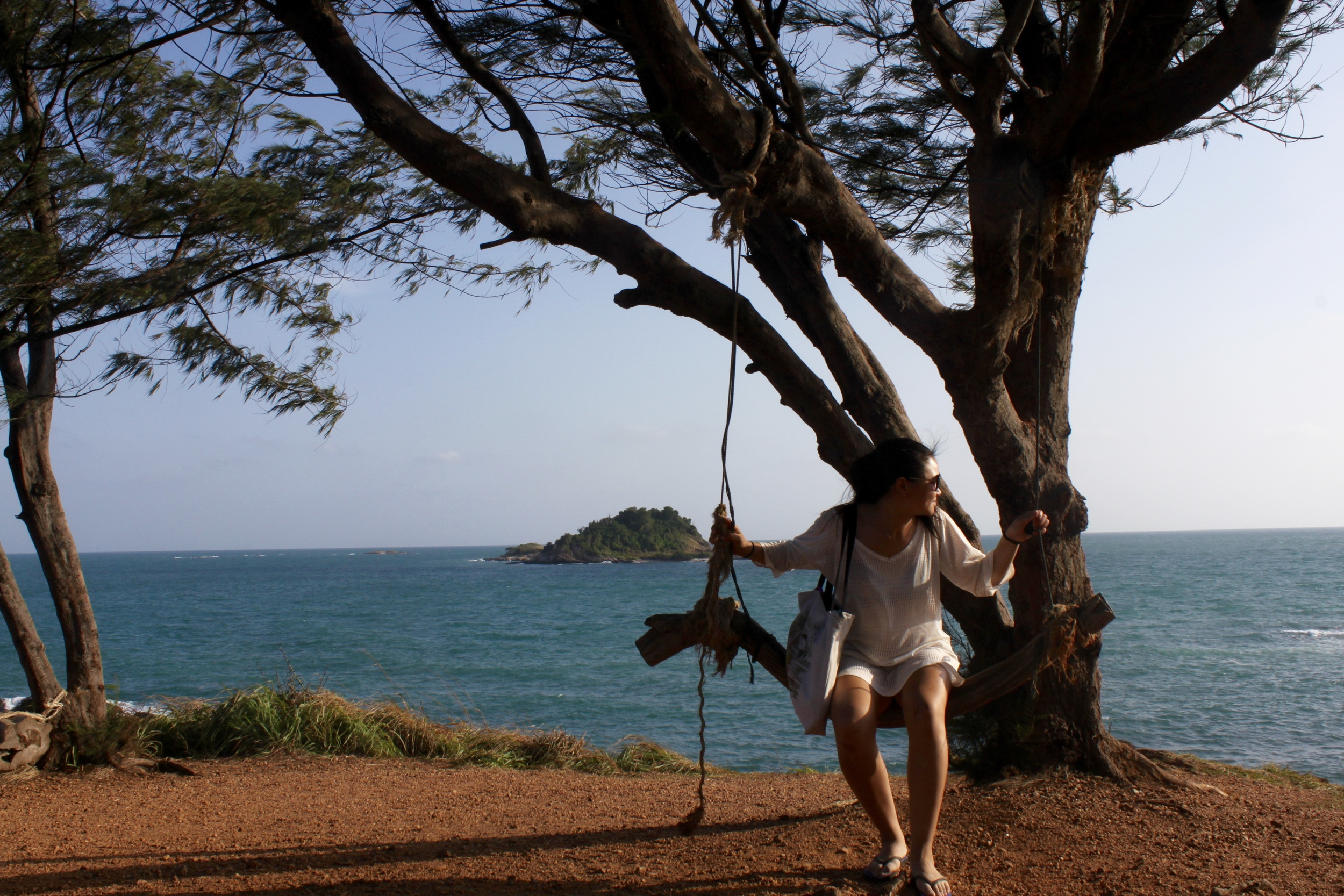 Sitting on a swing,  southern tip of Koh Samet