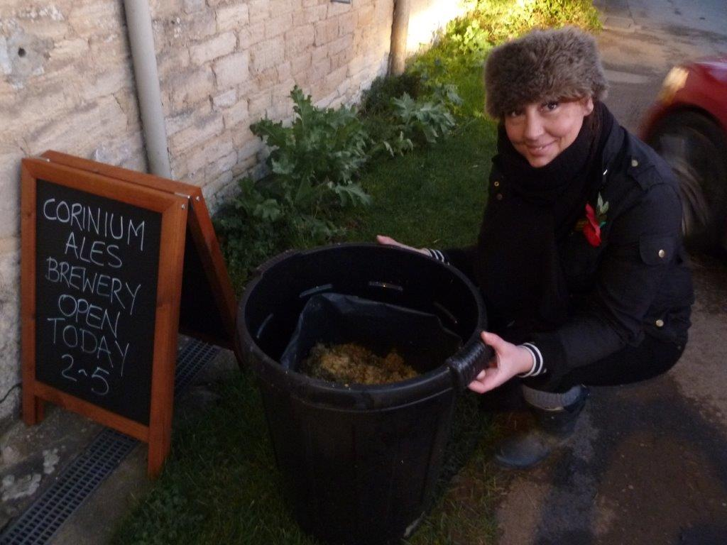 Vicky collecting the hops for her allotment compost heap
